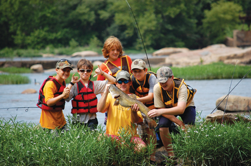 """Tee Clarkson, founder of Richmond-based outdoor camp Virginia Outside, says, """"A lot of families may not know exactly how to get their kids out fishing or mountain biking, so we like to create those opportunities."""""""