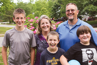 Anna Beth and Ed Kozusko of Midlothian conduct regular budget discussions around the dinner table to help their boys understand the importance of balancing expenses.
