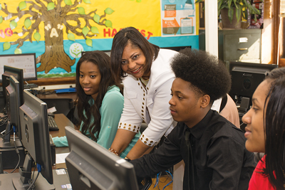 Roberta Aigbokhaevbo teaches personal finance at Thomas Jefferson High School in Richmond. She says students and their families have benefitted from the curriculum, taking the conversation from the classroom to the living room.
