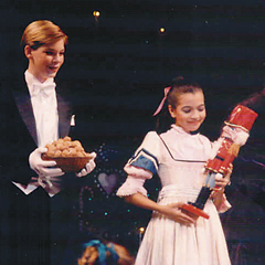 Maggie Small as Clara holds tight to her nutcracker.